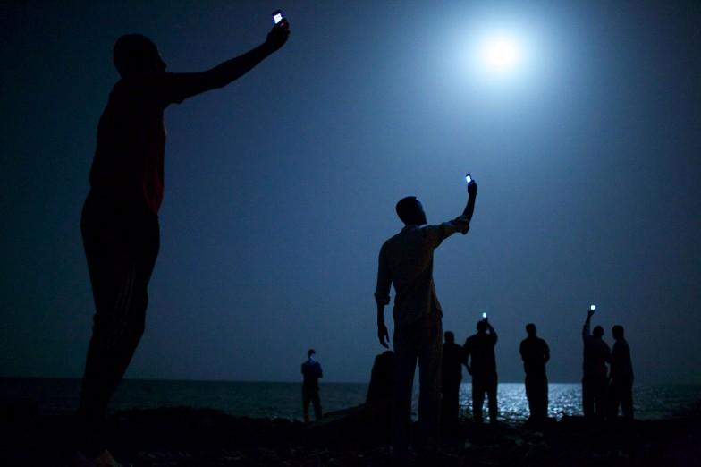 John Stanmeyer - World Press Photo of the Year - imigranți în Djibouti City